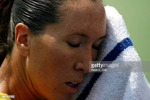 Jelena Jankovic of Serbia wipes sweat from her face during her match against Maria Kirilenko of Russia on Day 3 of the Western Southern Financial...