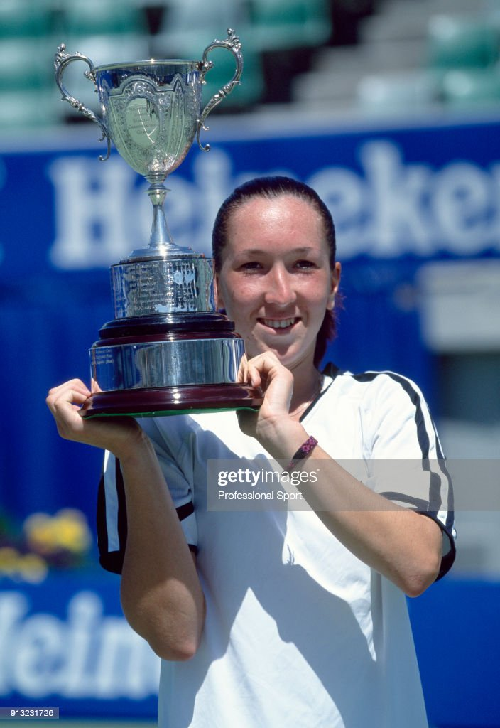 Jelena Jankovic of Yugoslavia lifts the trophy after defeating Sofia Arvidsson of Sweden (not in picture) in the Girls' Singles Final of the Australian Open Tennis Championships at Flinders Park in Melbourne, Australia circa January 2001.