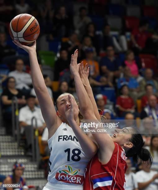 Jelena Milovanovic of Serbia trys to block France's Alexia Chartereau during the FIBA EuroBasket women's basketball match France v Serbia on June 17...