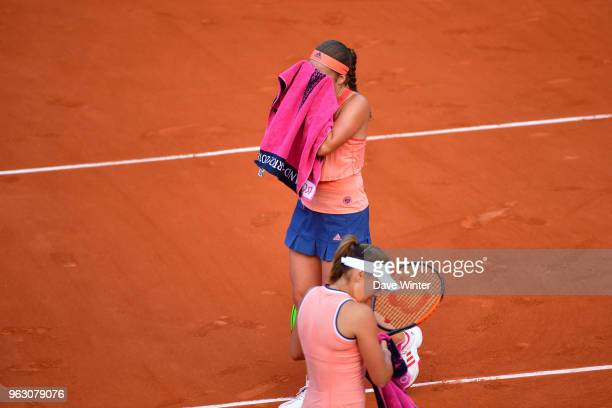 Jelena Ostapenko and Kateryna Kozlova during Day 1 of the the French Open at Roland Garros on May 27 2018 in Paris France