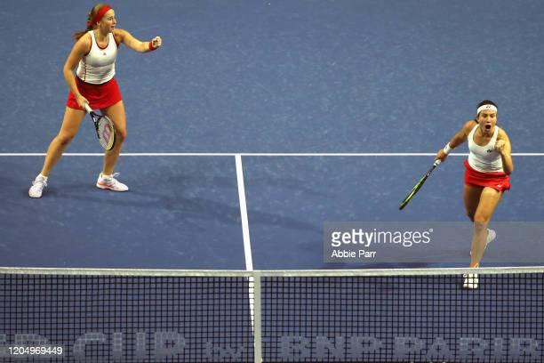 Jelena Ostapenko of Latvia and Anastasija Sevastova of Latvia react while competing against Sofia Kenin of USA and Bethanie MattekSands of USA in the...