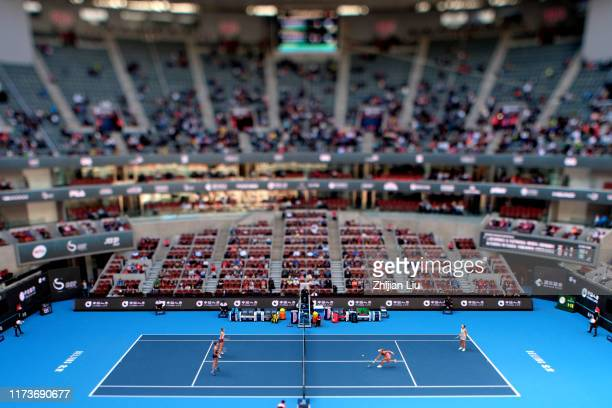 Jelena Ostapenko of Latvia and Dayana Yastremska of the Ukraine return a shot in their Women's doubles Semifinal match against Kristyna Pliskova of...