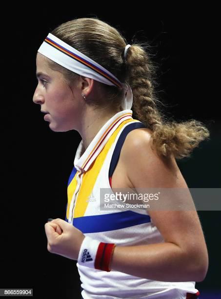 Jelena Ostapenko of Latvia celebrates a point in her singles match against Karolina Pliskova of Czech Republic during day 5 of the BNP Paribas WTA...