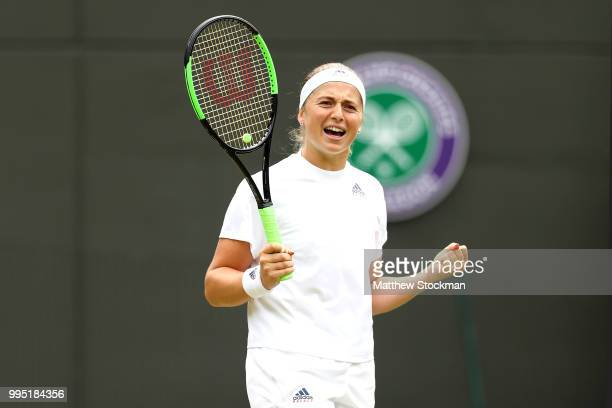 Jelena Ostapenko of Latvia celebrates after defeating Dominika Cibulkova of Slovakia in their Ladies' Singles QuarterFinals match on day eight of the...