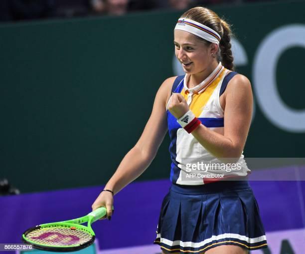 Jelena Ostapenko of Latvia celebrates after defeating Karolina Pliskova of Czech Republic during the WTA Finals tennis tournament in Singapore on...