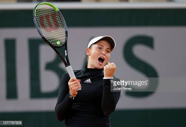 Jelena Ostapenko of Latvia celebrates after winning match point during her Women's Singles second round match against Karolina Pliskova of Czech...