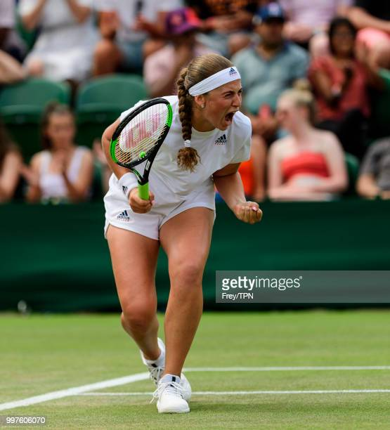 Jelena Ostapenko of Latvia celebrates against Aliaksandra Sasnovich of Belarus in the fourth round of the ladies' singles at the All England Lawn...