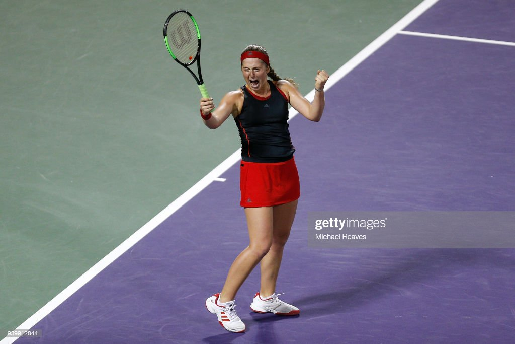 Jelena Ostapenko of Latvia celebrates match point after defeating Danielle Collins of the United States during their semifinal match on Day 11 of the Miami Open Presented by Itau at Crandon Park Tennis Center on March 29, 2018 in Key Biscayne, Florida.