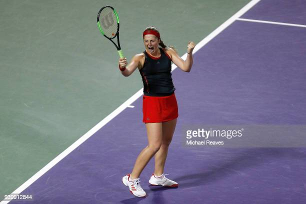 Jelena Ostapenko of Latvia celebrates match point after defeating Danielle Collins of the United States during their semifinal match on Day 11 of the...