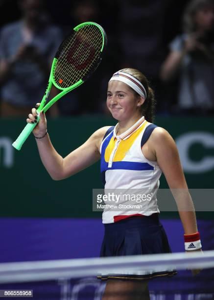 Jelena Ostapenko of Latvia celebrates victory in her singles match against Karolina Pliskova of Czech Republic during day 5 of the BNP Paribas WTA...