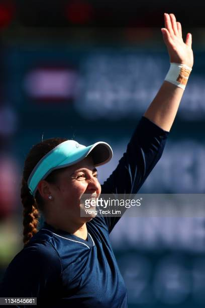 Jelena Ostapenko of Latvia celebrates winning her women's singles first round match against Shuai Zhang of China on Day 5 of the BNP Paribas Open at...