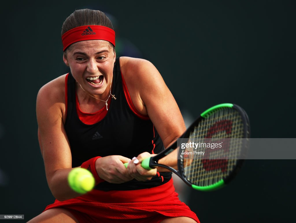 Jelena Ostapenko of Latvia hits a backhand during her match against Belinda Bencic of Switzerland during the BNP Paribas Open at the Indian Wells Tennis Garden on March 9, 2018 in Indian Wells, California.
