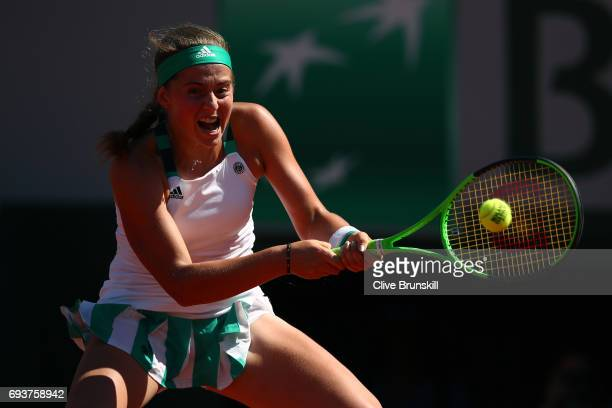 Jelena Ostapenko of Latvia hits a backhand during the ladies semi final match against Timea Bacsinszky of Switzerlandon day twelve of the 2017 French...