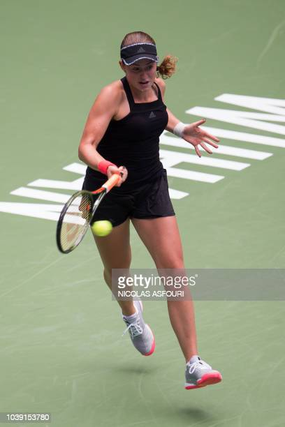 Jelena Ostapenko of Latvia hits a return against Daria Gavrilova of Australia during their women's singles second round match of the WTA Wuhan Open...