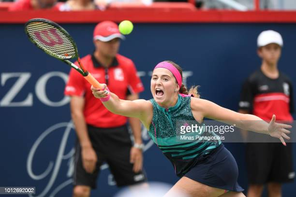 Jelena Ostapenko of Latvia hits a return against Johanna Konta of Australia during day two of the Rogers Cup at IGA Stadium on August 7 2018 in...