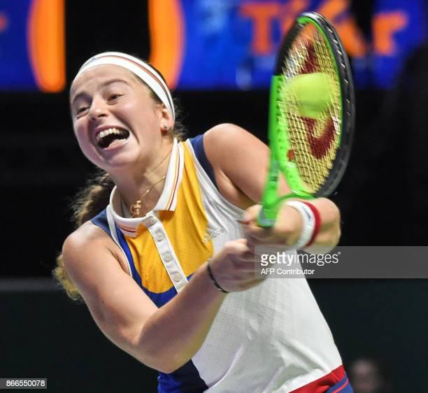 Jelena Ostapenko of Latvia hits a return against Karolina Pliskova of Czech Republic during the WTA Finals tennis tournament in Singapore on October...