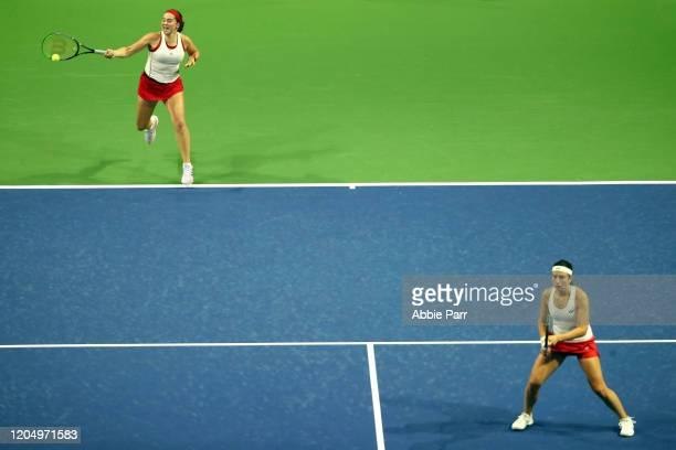 Jelena Ostapenko of Latvia hits the ball alongside Anastasija Sevastova of Latvia while competing against Sofia Kenin of USA and Bethanie MattekSands...