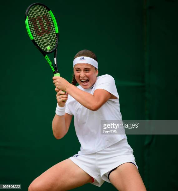 Jelena Ostapenko of Latvia in action against Aliaksandra Sasnovich of Belarus in the fourth round of the ladies' singles at the All England Lawn...