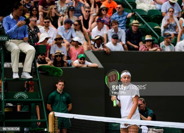 Jelena Ostapenko of Latvia in discussion with the umpire against Aliaksandra Sasnovich of Belarus in the fourth round of the ladies' singles at the...