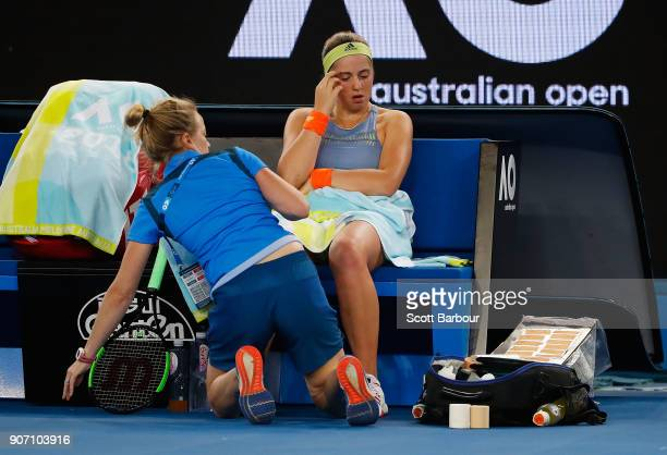 Jelena Ostapenko of Latvia is treated by a trainer in her third round match against Anett Kontaveit Estonia on day five of the 2018 Australian Open...