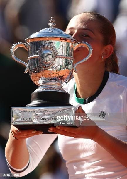 Jelena Ostapenko of Latvia kisses the Suzanne Lenglen Cup following her victory during the ladies singles final against Simona Halep of Romania on...