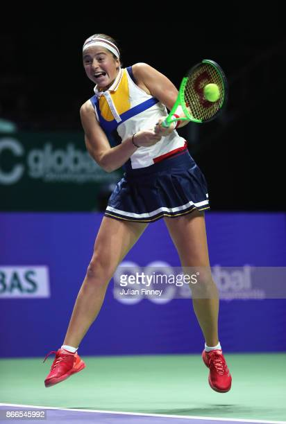 Jelena Ostapenko of Latvia plays a backhand in her singles match against Karolina Pliskova of Czech Republic during day 5 of the BNP Paribas WTA...