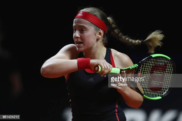 Jelena Ostapenko of Latvia plays a backhand to Zarina Diyas of Kazakhstan during day 4 of the Porsche Tennis Grand Prix at Porsche-Arena on April 26,...