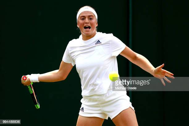 Jelena Ostapenko of Latvia plays a forehand against Aliaksandra Sasnovich of Belarus during their Ladies' Singles fourth round match on day seven of...