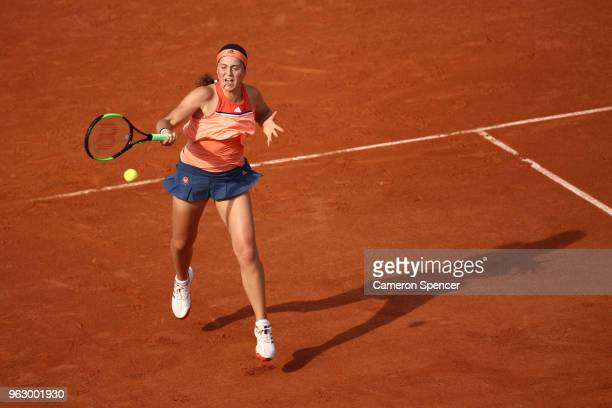 Jelena Ostapenko of Latvia plays a forehand during her ladies singles first round match against Kateryna Kozlova of Ukraine during day one of the...