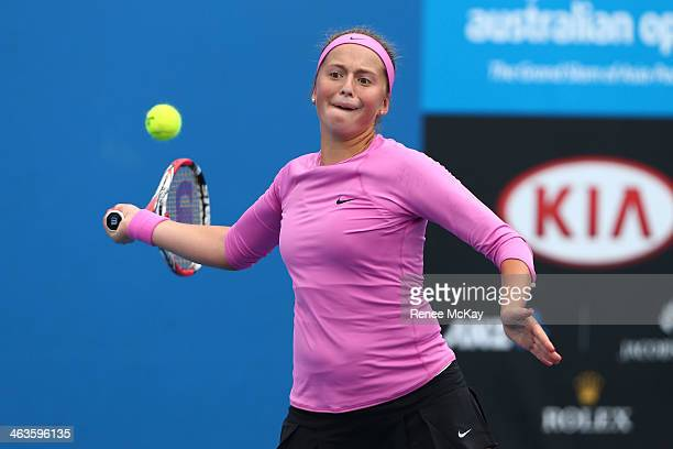 Jelena Ostapenko of Latvia plays a forehand in her first round junior girls' match against Kaylah McPhee of Australia during the 2014 Australian Open...