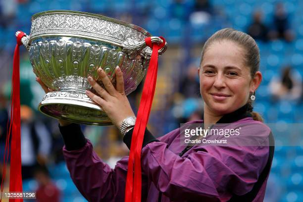 Jelena Ostapenko of Latvia poses for a photo with the trophy after winning the women's singles final aganst Anett Kontaveit of Estonia during day 8...