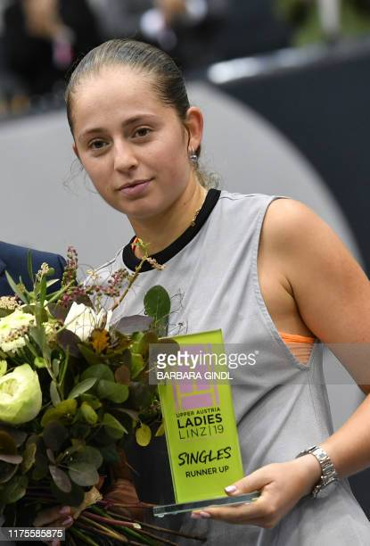 Jelena Ostapenko of Latvia poses with her trophy after her WTA-Upper Austria Ladies final tennis match against Cori Gauff of US, on October 13, 2019...