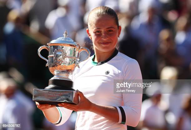 Jelena Ostapenko of Latvia poses with the Suzanne Lenglen Cup following her victory during the ladies singles final against Simona Halep of Romania...