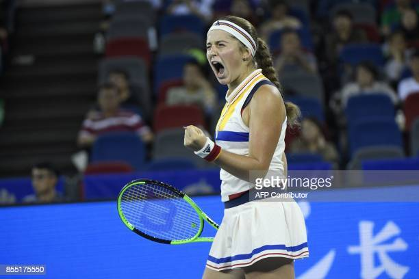 Jelena Ostapenko of Latvia reacts after winning a point against Maria Garbine Muguruza of Spain during their women's singles quarterfinal match at...