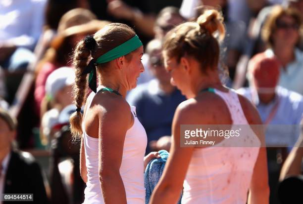 Jelena Ostapenko of Latvia reacts as she walks past her opponant Simona Halep of Romania following a lucky net cord shot during the ladies singles...