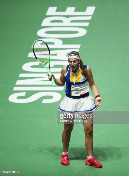 Jelena Ostapenko of Latvia reacts in the singles match against Garbine Muguruza of Spain during day 1 of the BNP Paribas WTA Finals Singapore...