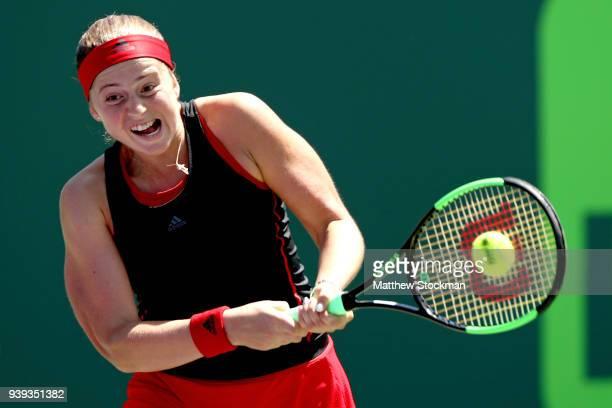 Jelena Ostapenko of Latvia returns a shot to Elina Svitolina of Ukraine during the quarterfinals of the Miami Open Presented by Itau at Crandon Park...