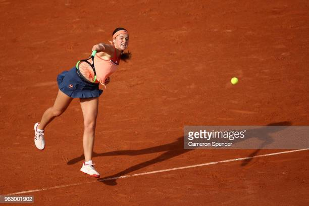 Jelena Ostapenko of Latvia serves during her ladies singles first round match against Kateryna Kozlova of Ukraine during day one of the 2018 French...