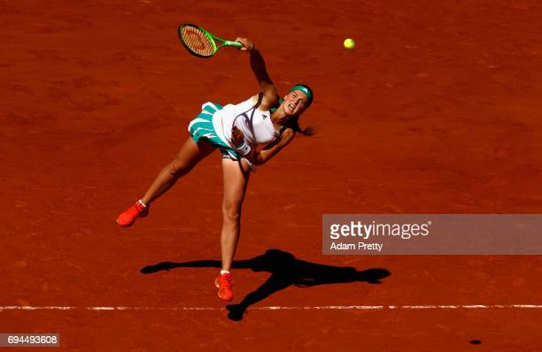 Jelena Ostapenko of Latvia serves during the ladies singles final match against Simona Halep of Romania on day fourteen of the 2017 French Open at...