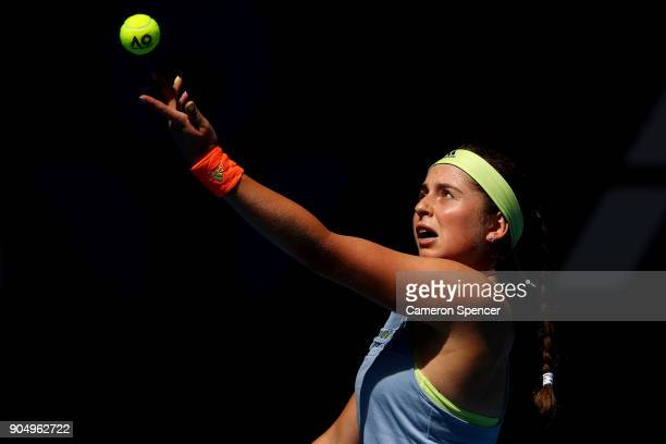 Jelena Ostapenko of Latvia serves in her first round match against Francesca Schiavone of Italy on day one of the 2018 Australian Open at Melbourne...