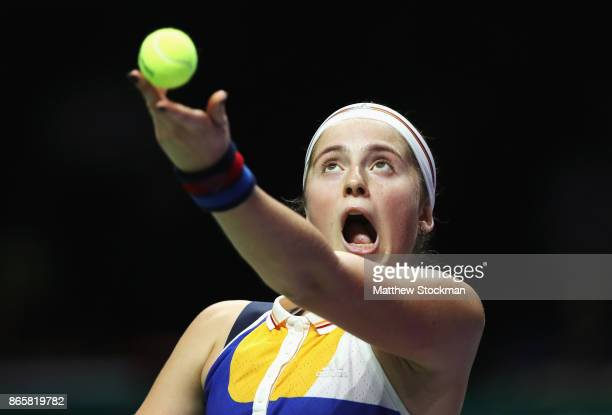 Jelena Ostapenko of Latvia serves in her singles match against Venus Williams of the United States during day 3 of the BNP Paribas WTA Finals...