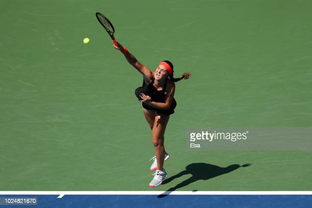 Jelena Ostapenko of Latvia serves the ball during her women's singles first round match against Andrea Petkovic of Germany on Day Two of the 2018 US...