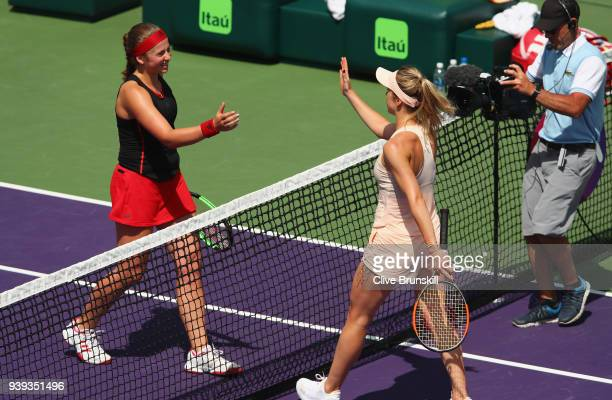 Jelena Ostapenko of Latvia shakes hands at the net after her straight sets victory against Elina Svitolina of Ukraine in their quarter final during...