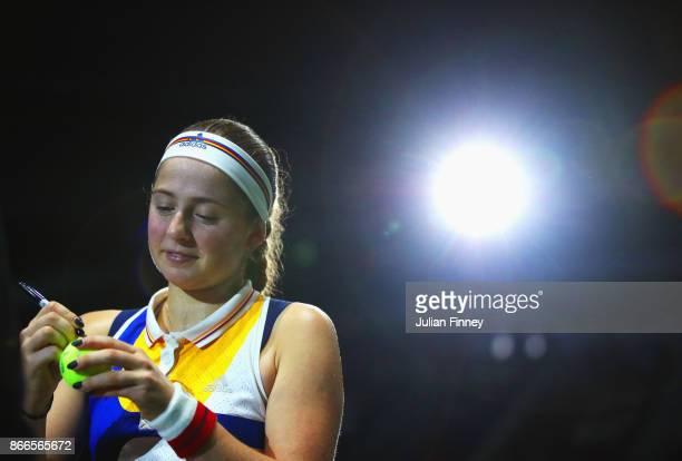 Jelena Ostapenko of Latvia signs autographs after her singles match against Karolina Pliskova of Czech Republic during day 5 of the BNP Paribas WTA...