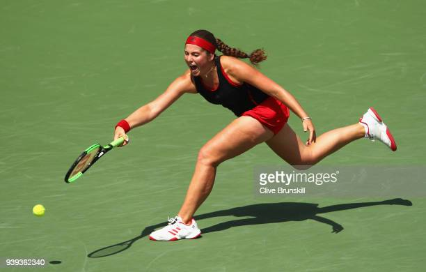 Jelena Ostapenko of Latvia stretches to play a forehand against Elina Svitolina of Ukraine in their quarter final during the Miami Open Presented by...