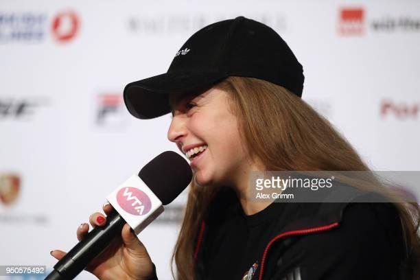 Jelena Ostapenko of Latvia talks to the media during day 2 of the Porsche Tennis Grand Prix at PorscheArena on April 24 2018 in Stuttgart Germany