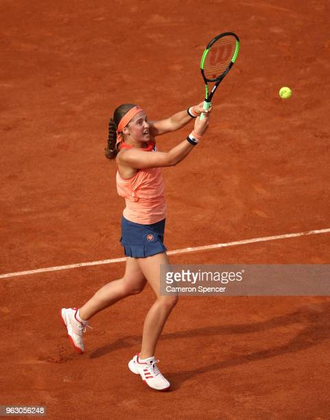 Jelena Ostapenko of Latvia volleys during her ladies singles first round match against Kateryna Kozlova of Ukraine during day one of the 2018 French...