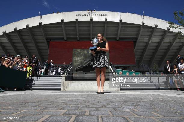 Jelena Ostapenko of Latvia, winner of the ladies singles competition poses with the Suzanne Lenglen Trophy outside the Suzanne Lenglen Statue on day...