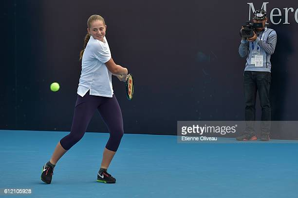 Jelena Ostapenko of Lithuania attends a LeMobile Clinic event on day three of the 2016 China Open at the National Tennis Centre on October 3 2016 in...