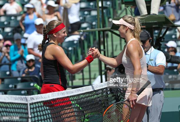 Jelena Ostapenko of Ukraine left greets Elina Svitolina of Latvia after defeating her 76 76 during their match at Miami Open tennis tournament on...
